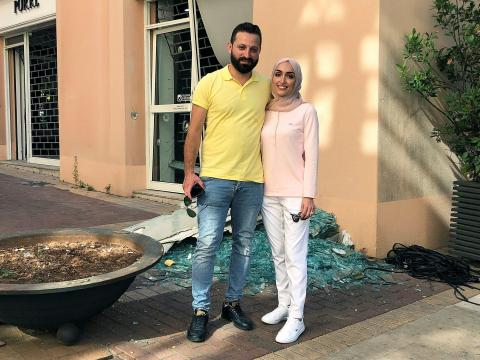 Bride Israa Seblani poses for a picture with her husband Ahmad Subeih in Beirut REUTERS/Yara Abi