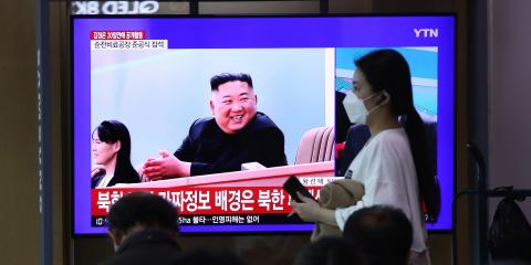 People watch a television broadcast reporting an image of North Korean leader Kim Jong Un on May 2, 2020. Chung Sung-Jun/Getty Images