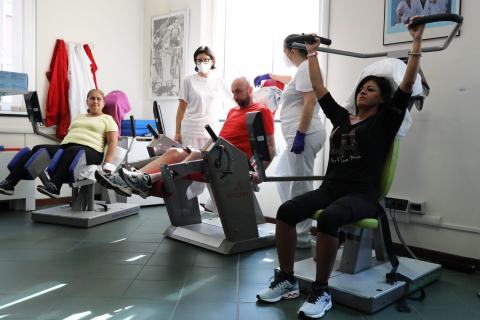 Recovering coronavirus patients train on a machine to strengthen muscle tone at the Department of Rehabilitative Cardiology in Genoa, Italy, on July 22, 2020. Marco Di Lauro/Getty Images