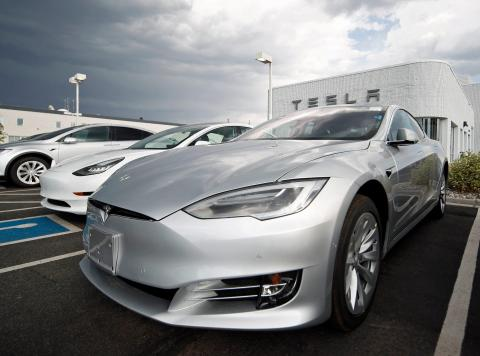 In this Sunday, July 8, 2018, photograph, 2018 Model 3 sedans sit on display outside a Tesla showroom in Littleton, Colo. AP Photo/David Zalubowski