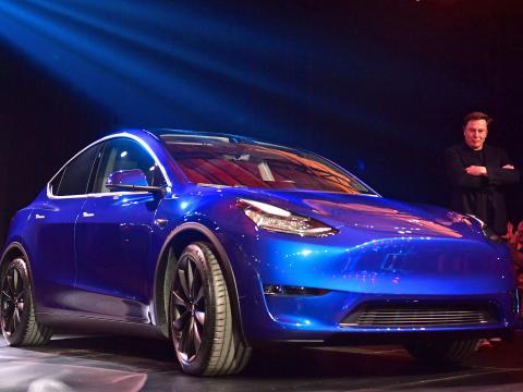 Tesla CEO Elon Musk views the new Tesla Model Y at its unveiling in Hawthorne, California on March 14, 2019. FREDERIC J. BROWN/AFP/Getty Images