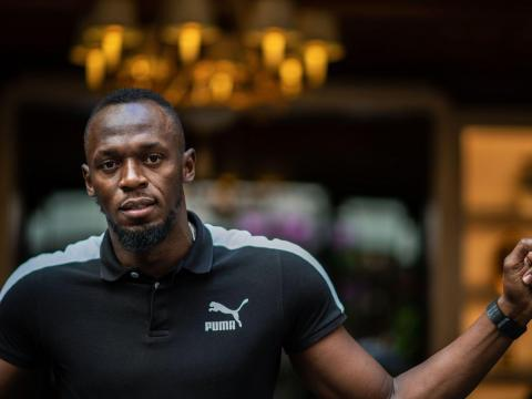 """Jamaican Olympic sprinter Usain Bolt poses during a photo session as he launches a new brand of electric scooters named """"Bolt"""" in Paris, on May 15, 2019. MARTIN BUREAU/AFP via Getty Images"""