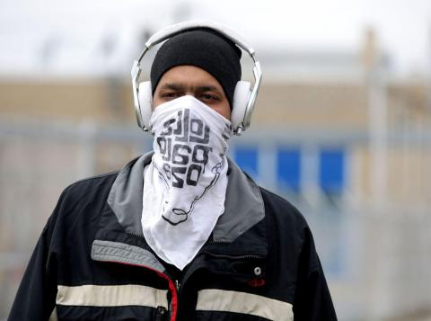 Kevin Houston uses a bandana to cover his face on April 23, 2020, in Evanston, Illinois. Stacey Wescott/Chicago Tribune/Tribune News Service/Getty Images