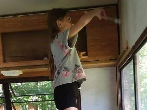 Lauren painting the camper. Courtesy of Aimee Nelson