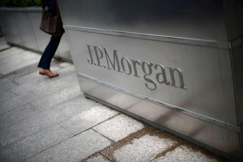 A man walks into the JP Morgan headquarters at Canary Wharf in London. Reuters