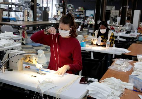 A woman sews hospital masks at the Detroit Sewn facility in Pontiac, Michigan, on March 23, 2020. Rebecca Cook/Reuters