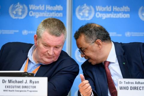 World Health Organization Director-General Tedros Adhanom Ghebreyesus (right) speaks with WHO Health Emergencies Programme Director Dr. Michael Ryan during a press briefing on COVID-19 at the WHO headquarters in Geneva on March 6, 2020.