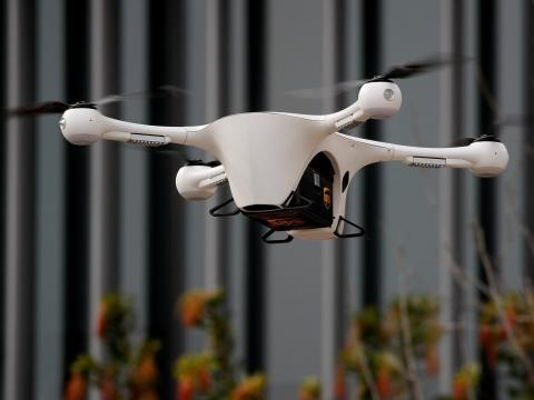 FILE PHOTO: A Matternet drone and UPS container flies through the air as UC San Diego Health launch a pilot project testing the use of aerial drones to transport medical samples, supplies and documents between hospitals in La Jolla, California