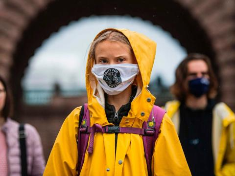 "Swedish climate activist Greta Thunberg protests during a ""Fridays for Future"" protest in front of the Swedish Parliament Riksdagen in Stockholm on October 9, 2020."