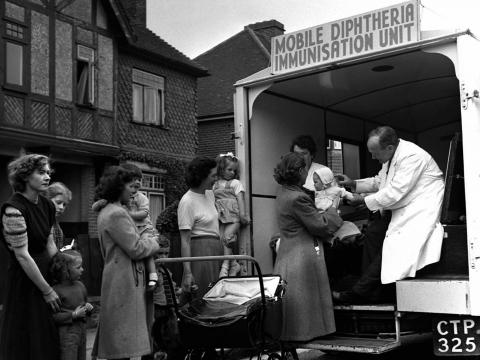The UK National Health Service at work in Portsmouth, where mobile immunization vans like this one helped reduced the risk of diphtheria cases from 776 twenty years prior to 1 in 1950. Doctors gave more than 37,000 various injections.