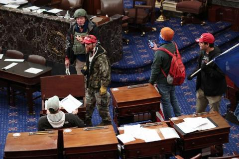 Protesters enter the Senate Chamber.