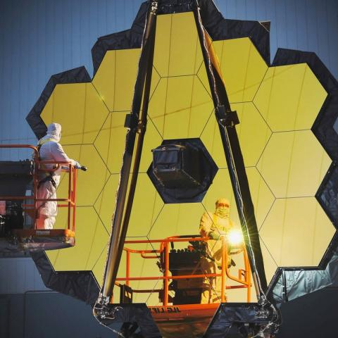 Engineers and technicians work on the James Webb Space Telescope, October 14, 2016.