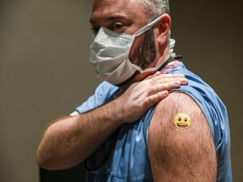Dr. Jason Smith showed off his bandage after getting vaccinated at the University of Louisville Hospital in Kentucky.