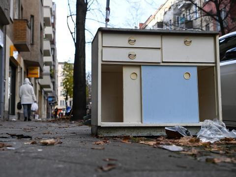 Unwanted furniture on a sidewalk in Berlin.
