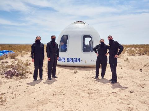 team stand in front of capsuleBlue Origin