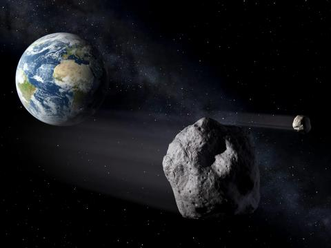 An artist's illustration of asteroids flying by Earth.