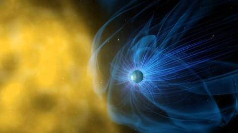 Ilustración del campo magnético de la Tierra, en azul, que protege al planeta de la radiación solar.