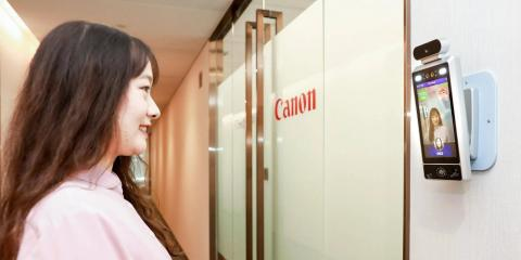 A woman smiles at an AI camera
