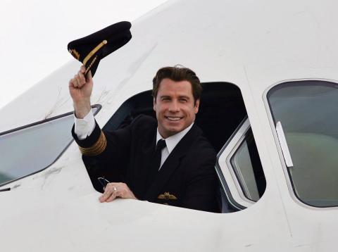 John Travolta en un avión