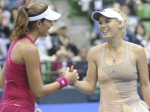 Caroline Wozniacki y Garbiñe Muguruza