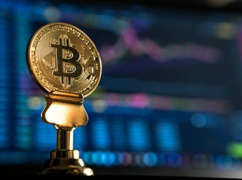 Una imagen de un logo de bitcoin.