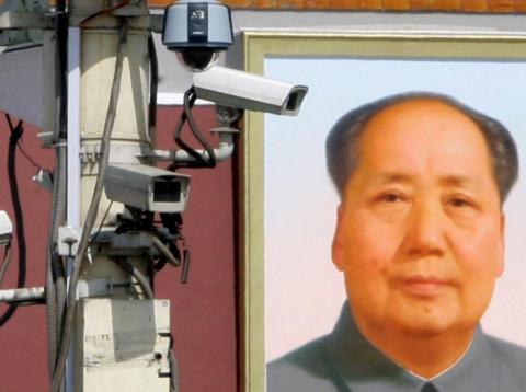 Surveillance cameras in front of the giant portrait of Chairman Mao Zedong at Beijing's Tiananmen Square in September 2009. China is increasingly monitoring on citizens' behavior.