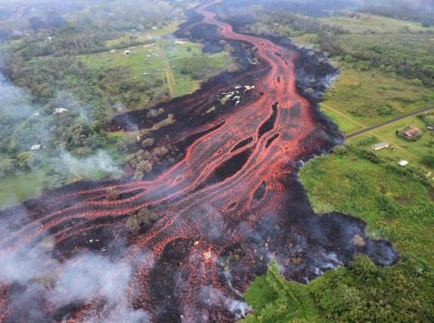 Lava flowing from fissures near Pahoa, Hawaii.