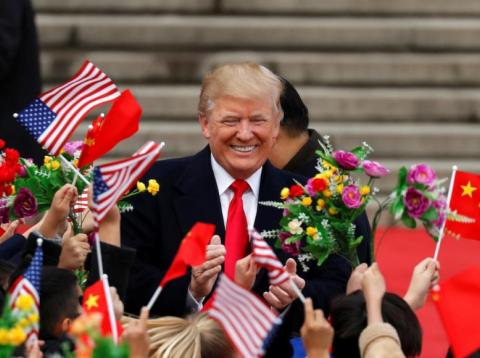 President Donald Trump arriving for a welcoming ceremony in Beijing on November 9.