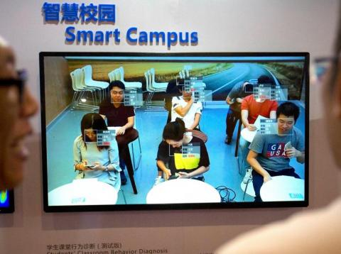 Visitors viewing a display of electronic facial-recognition technology that claims to be able to detect when students are talking or looking at their cellphones at the 21st China Beijing International High-tech Expo in Beijing.