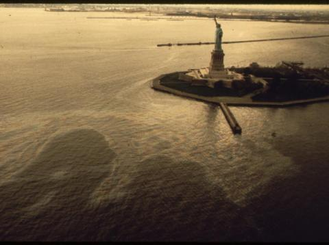 In the first six months of 1973, more than 300 oil spills occurred in the New York City area. An oil slick creeps up on the Statue of Liberty in this 1973 photo.