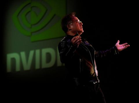 Jensen Huang, CEO of Nvidia, reacts to a video at his keynote address at CES in Las Vegas