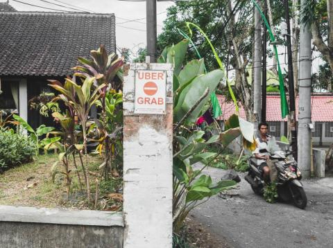 """Signs dictating certain areas as """"no-go"""" zones for Uber, Grab, and other ride-sharing services are all over Bali."""