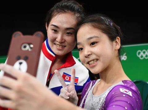 Lee Eun-Ju of South Korea takes a selfie with Hong Un Jong of North Korea during the Winter Olympics.