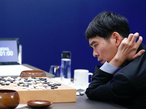 Lee Sedol, a champion Go player, plays against Google's AlphaGo AI. AlphaGo would win every game bar one.