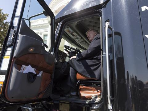 President Donald Trump sits in a truck.