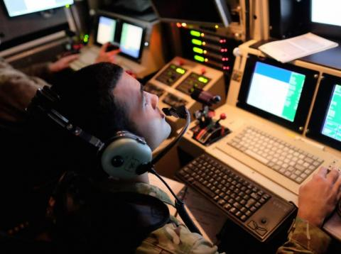 US airmen control an Air Force drone from a command trailer at Kandahar Air Field, Afghanistan March 9, 2016.