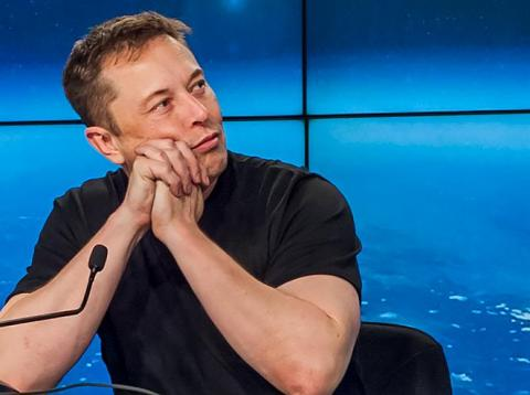 Elon Musk, the founder of SpaceX, watches a replay of the first launch of Falcon Heavy during a press conference on February 6, 2018.