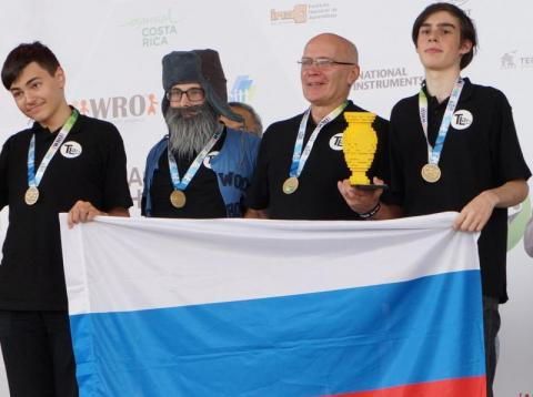 Left to right: Maksim Mikhailov and his team: Daniil Nechaev, Igor Lositsky and Gleb Zagarskikh, as they accept the gold medal at the 2017 World Robot Olympiad.