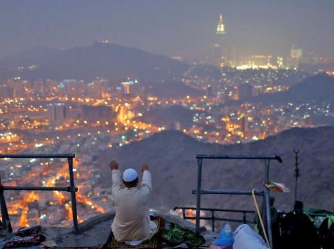 A pilgrim prays at Mount Al-Noor, a holy site near Mecca, Saudi Arabia.