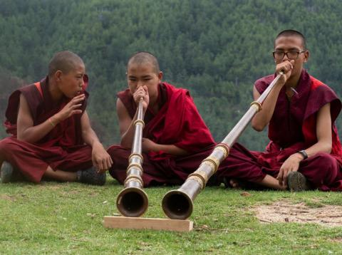 Teenage monks practice playing prayer flutes at the Dechen Phodrang monastery on June 14, 2018, in Thimphu, Bhutan.