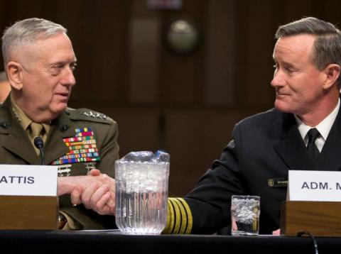 US Marine Corps Gen. James Mattis and US Navy Adm. William McRaven shake hands on Capitol Hill in Washington, March 5, 2013.