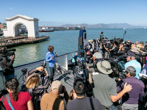 Boyan Slat talks to reporters before the Ocean Cleanup launches their first array.