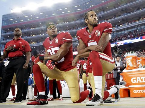 Colin Kaepernick, right, began kneeling during the national anthem before NFL games as a protest against police brutality and racial injustice.