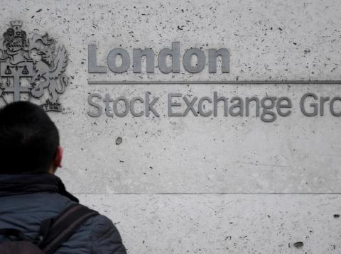 People walk past the London Stock Exchange Group offices in the City of London, Britain, December 29, 2017.