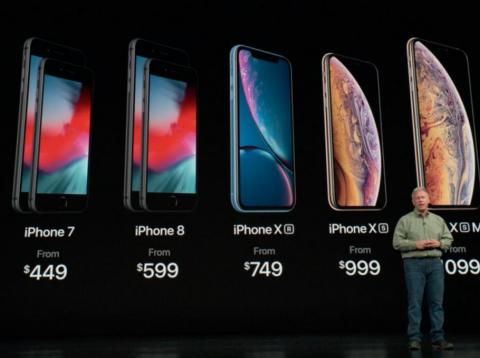 Phil Schiller, Apple's head of worldwide marketing, shows off the company's updated iPhone lineup on Wednesday.