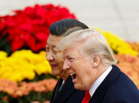 President Trump takes part in a welcoming ceremony with China's President Xi Jinping in Beijing.