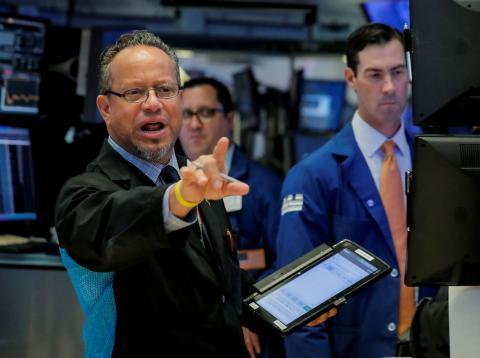 Traders en el parqué de Wall Street.