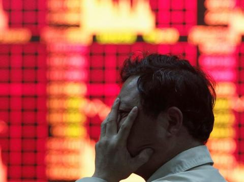 A man at a brokerage house in Shanghai in 2010.