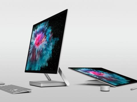 "The Microsoft Surface Studio 2 can fold down into ""studio mode,"" letting you draw and sketch right on its big, beautiful screen. The Surface Dial, seen on the right, is an optional accessory that's sold separately."