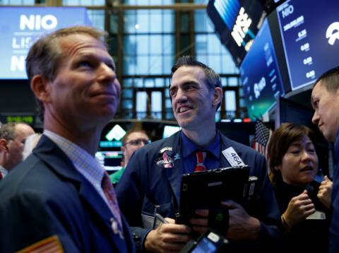 Traders operando en Wall Street